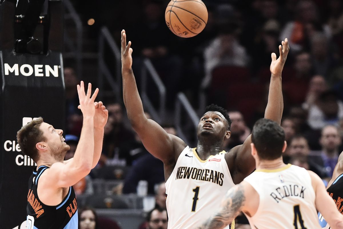 Cleveland Cavaliers guard Matthew Dellavedova and New Orleans Pelicans forward Zion Williamson go for a rebound during the second half at Rocket Mortgage FieldHouse.