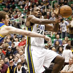 Jazz forward Paul Millsap (24) loses possession of the ball during the first half of the NBA basketball game between the Utah Jazz and the Golden State Warriors at Energy Solutions Arena, Wednesday, Dec. 26, 2012.