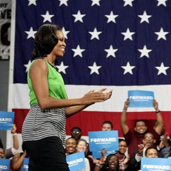 First lady Michelle Obama is greeted during an appearance at North Carolina Central University in Durham, N.C., Wednesday, Sept. 19, 2012.