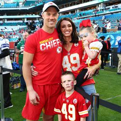 Kansas City's Daniel Sorensen poses on the field with wife Whitney and their two children.