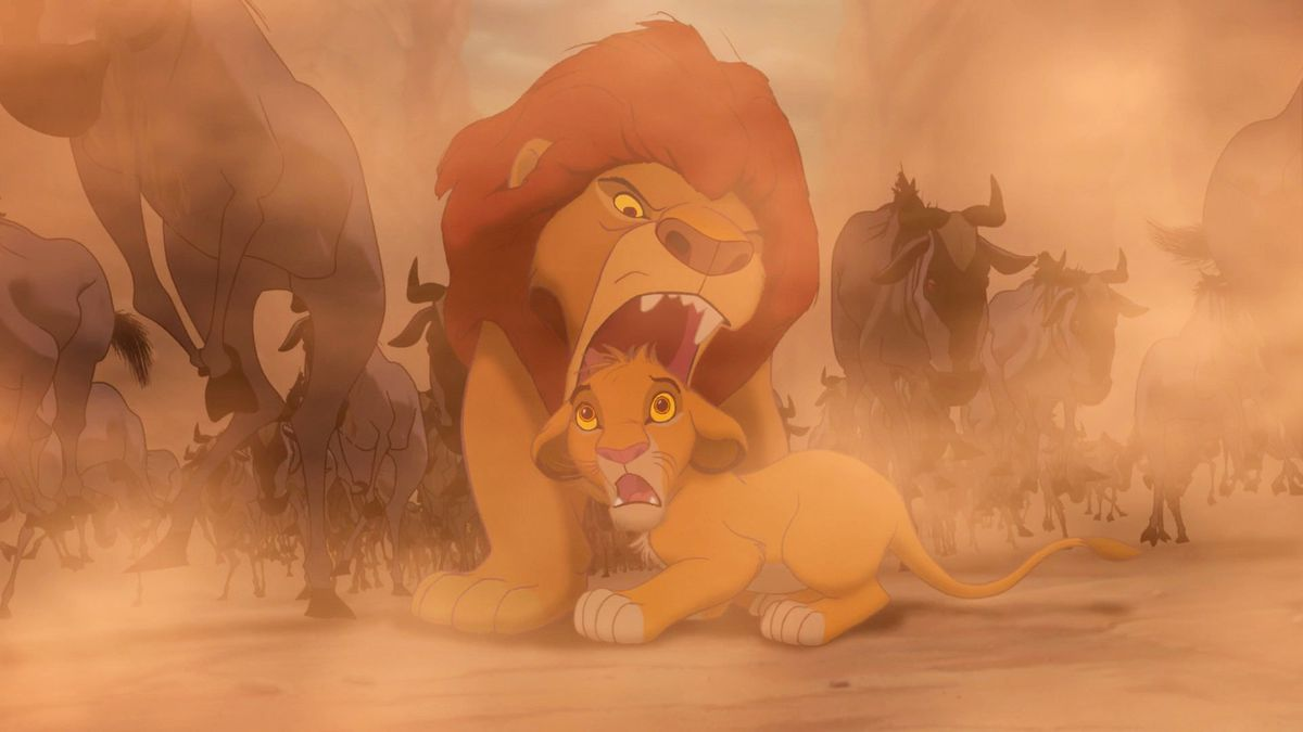 Simba's father about to grab his son to save him from the stampede