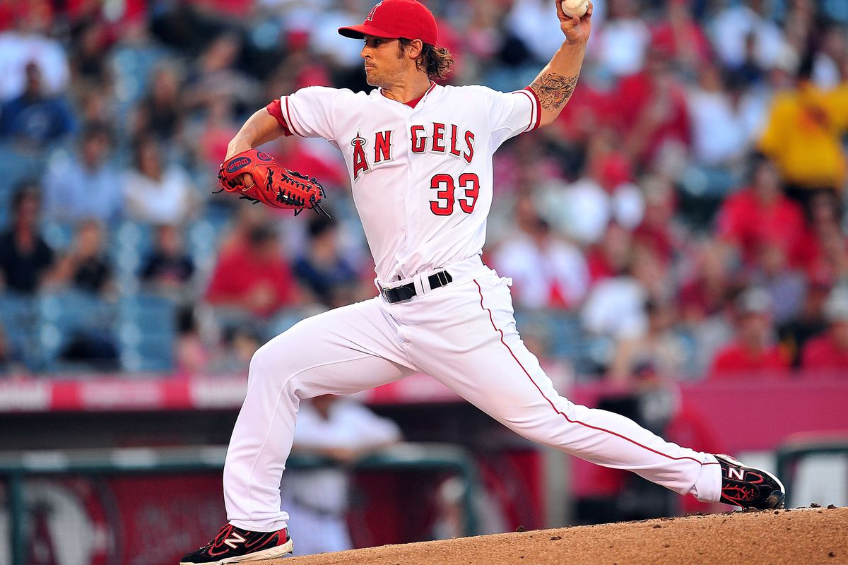 July 28, 2012; Anaheim, CA, USA; Los Angeles Angels starting pitcher C.J. Wilson (33) pitches in the first inning against the Tampa Bay Rays at Angel Stadium. Mandatory Credit: Gary A. Vasquez-US PRESSWIRE