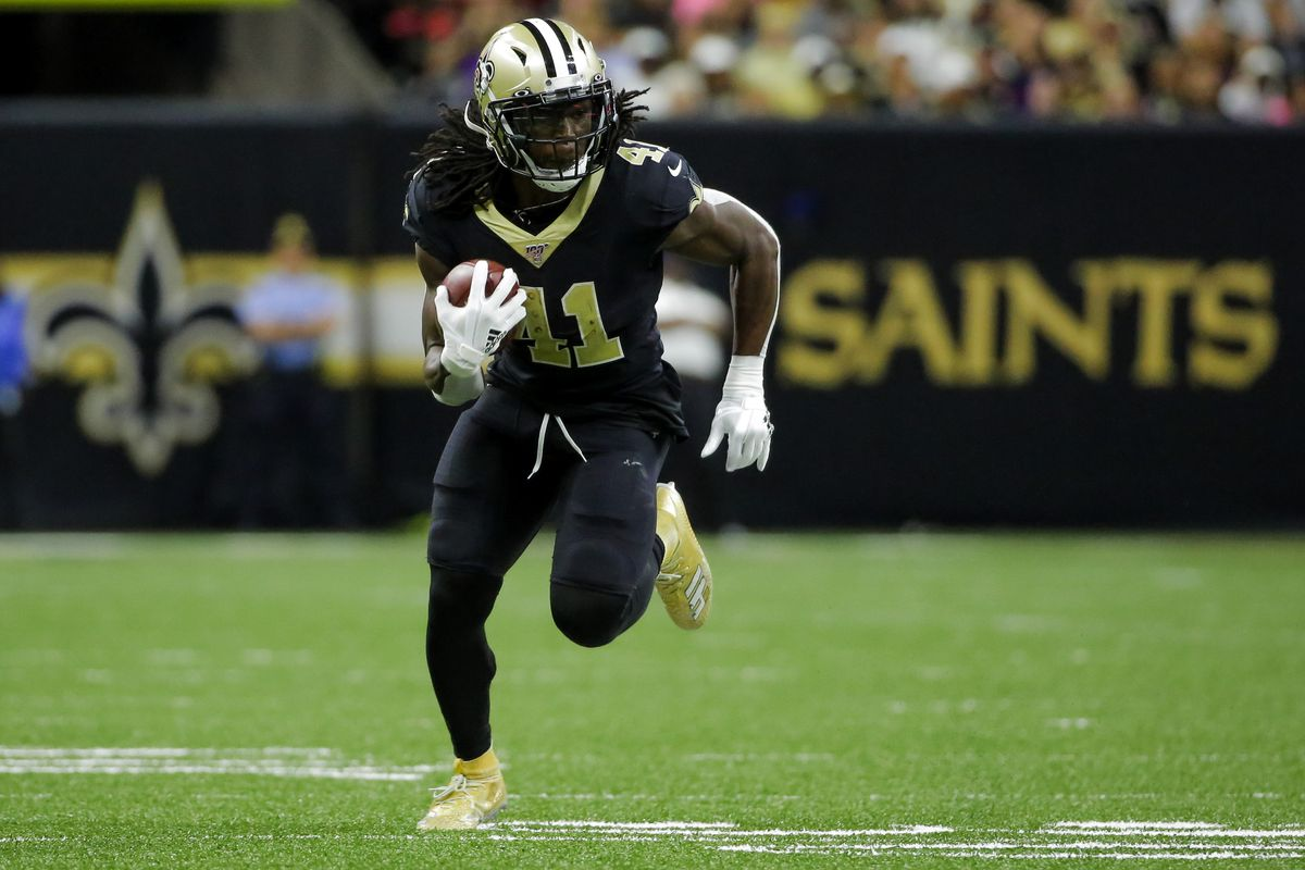 New Orleans Saints running back Alvin Kamara runs against the Tampa Bay Buccaneers during the fourth quarter at the Mercedes-Benz Superdome.