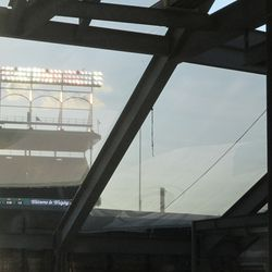 View of lights and ribbon board through the Ernie Banks tarps in right field -