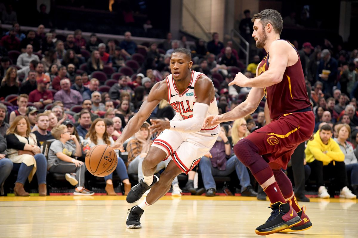 Kris Dunn of the Chicago Bulls drives around Kevin Love of the Cleveland Cavaliers during the first half at Rocket Mortgage Fieldhouse on January 25, 2020 in Cleveland, Ohio.