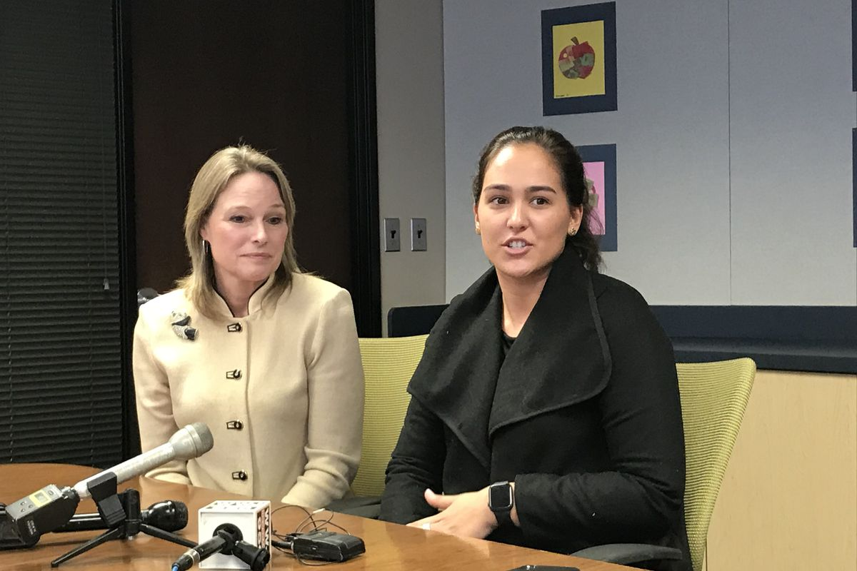 Karen Pastor, left, a veteran Detroit teacher, sits with Samantha Ciaffone during a news conference Wednesday. Pastor is mentoring Ciaffone through a new program in the Detroit Public Schools Community District.