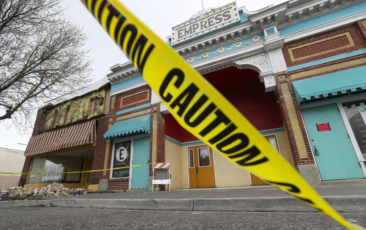 Caution tape surrounds a damaged building on Magna's Main Street on Tuesday, March 24, 2020, following a 5.7 magnitude earthquake that was centered near the city on March 18. The street is now open to traffic.