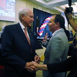 Sens. Orrin Hatch and Mike Lee, both R-Utah, greet each other on election night in Salt Lake City, Tuesday, Nov. 4, 2014.
