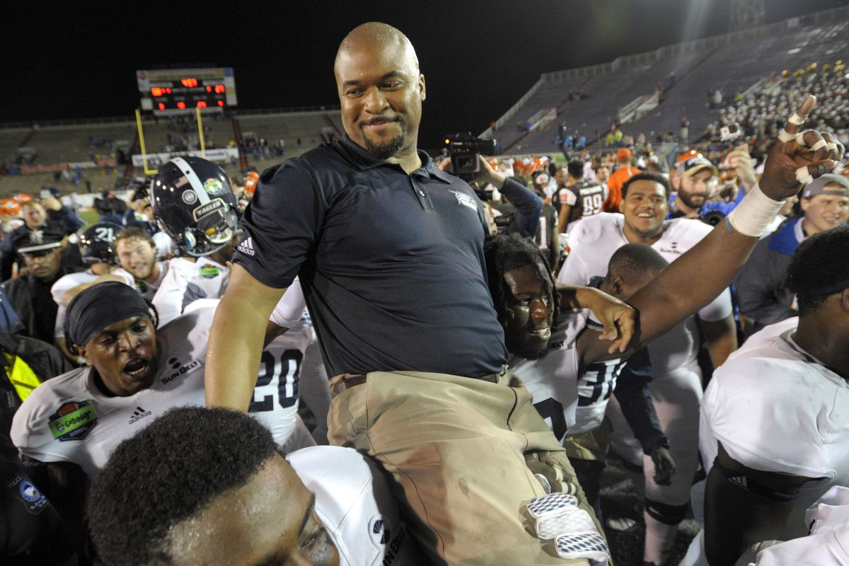 Ah...nothing says Bowl Season like an Interim Coach getting carried off the field