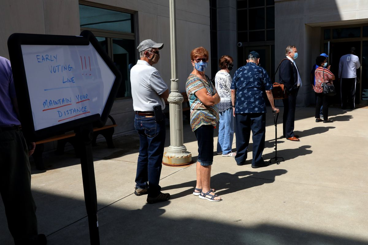 Voters in downstate Edwardsville stand in line on the first day of early voting in Illinois on Sept. 24, 2020.