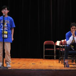 Aaron Chang (left) from the Audubon Elementary School and Maya Joshi from the Young Magnet High School on the stage during one of the final rounds of the annual Citywide Spelling Bee Championship at the Lindblom Math and Science Academy on March 14, 2019. The winner will earn the opportunity to represent Chicago Public Schools at the Scripps National Spelling Bee in Washington, D.C., where they will compete against the best spellers from across the nation for the title of 2019 national Spelling Bee Champion and an opportunity to win a $40,000 prize. | Victor Hilitski/For the Sun-Times