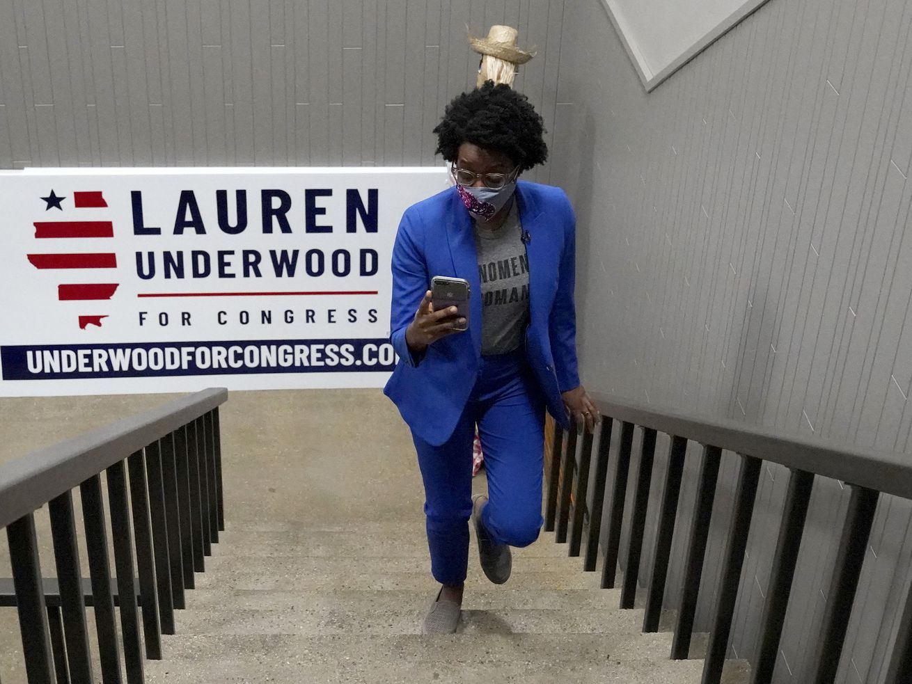 Congresswoman Lauren Underwood checks her phone as she walks up her office at an election night headquarter in St. Charles, Ill., Tuesday, Nov. 3, 2020. Lauren Underwood of Naperville and Jim Oberweis of Sugar Grove are the candidates for the 14th U.S. Congressional District seat. (AP Photo/Nam Y. Huh) ORG XMIT: ILNH104