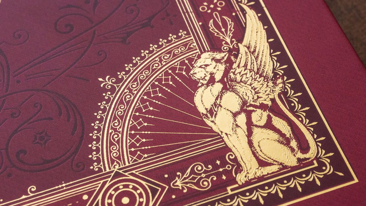 A close-up of the detail on the alternate front cover of Candlekeep Mysteries, with gold foil embossed graphics.