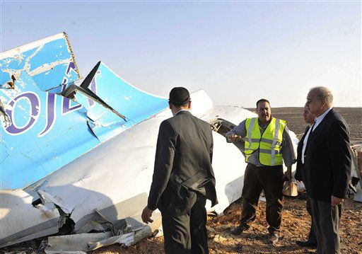 Sherif Ismail (right) looks at the remains of a crashed passenger jet in Hassana, Egypt, on Saturday, Oct. 31, 2015. | Suliman el-Oteify/Egyptian Prime Minister's Office via AP