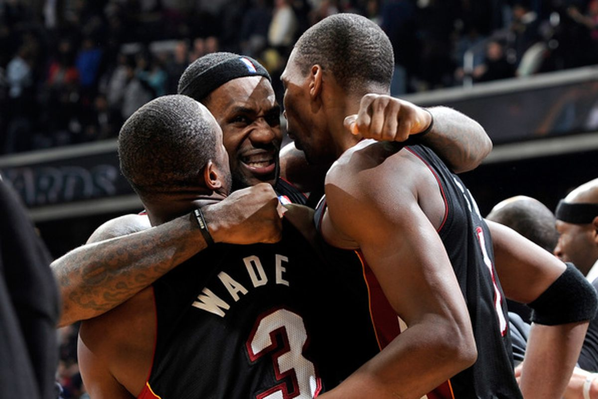 LeBron James of the Miami Heat celebrates with Dwyane Wade and Chris Bosh after a 95-94 victory over the Washington Wizards at the Verizon Center on December 18 2010 in Washington DC.