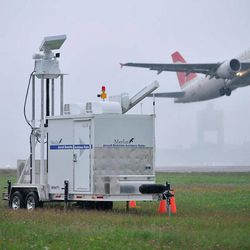 FILE- In this July 7, 2009 file photo, Andreas Smith, project manager for DeTect, Inc., of Panama City, Fla., watches for birds flying near an active runway at Logan International Airport in Boston. Smith was part of the team calibrating a radar unit designed to help avoid aircraft bird strikes at the airport. Although there is evidence that bird-control efforts near airports are paying off, U.S. Sen. Kirsten Gillibrand, D-NY, introduced legislation on Wednesday, April 25, 2012 that would make it easier to round up geese near JFK Airport and kill them, after a second airliner was forced from the skies over New York due to a bird strike.