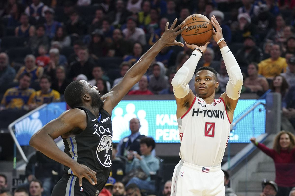 Houston Rockets guard Russell Westbrook shoots the basketball against Golden State Warriors forward Draymond Green during the second quarter at Chase Center.