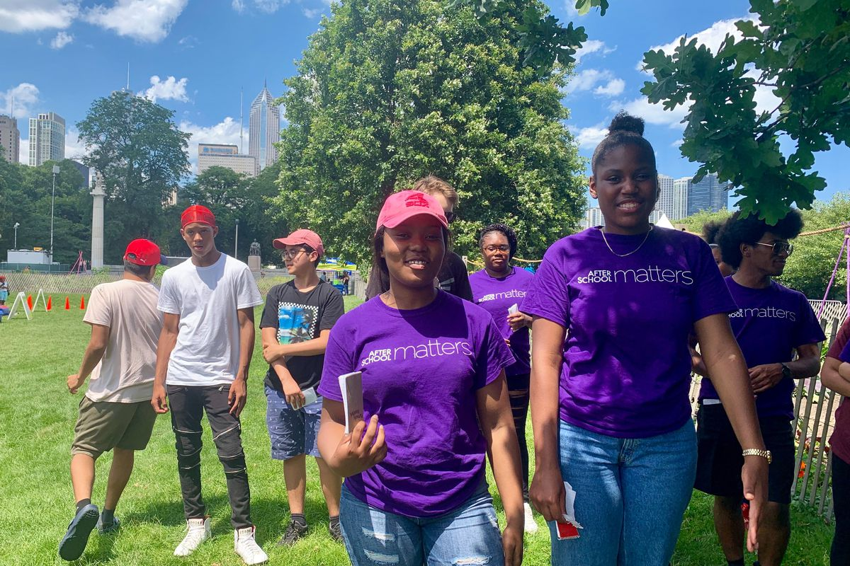 Kennedy Woodfork, left, and Alyssa Goodwin, participating in a summer program with the the Urban Grower's Collective, lead a tour of their community garden in Grant Park on July 10.