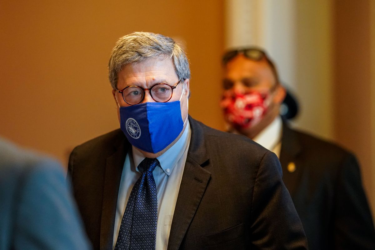 A photo of Attorney General William Barr wearing a blue face mask as he leaves the office of Senate Majority Leader Mitch McConnell at the Capitol Building