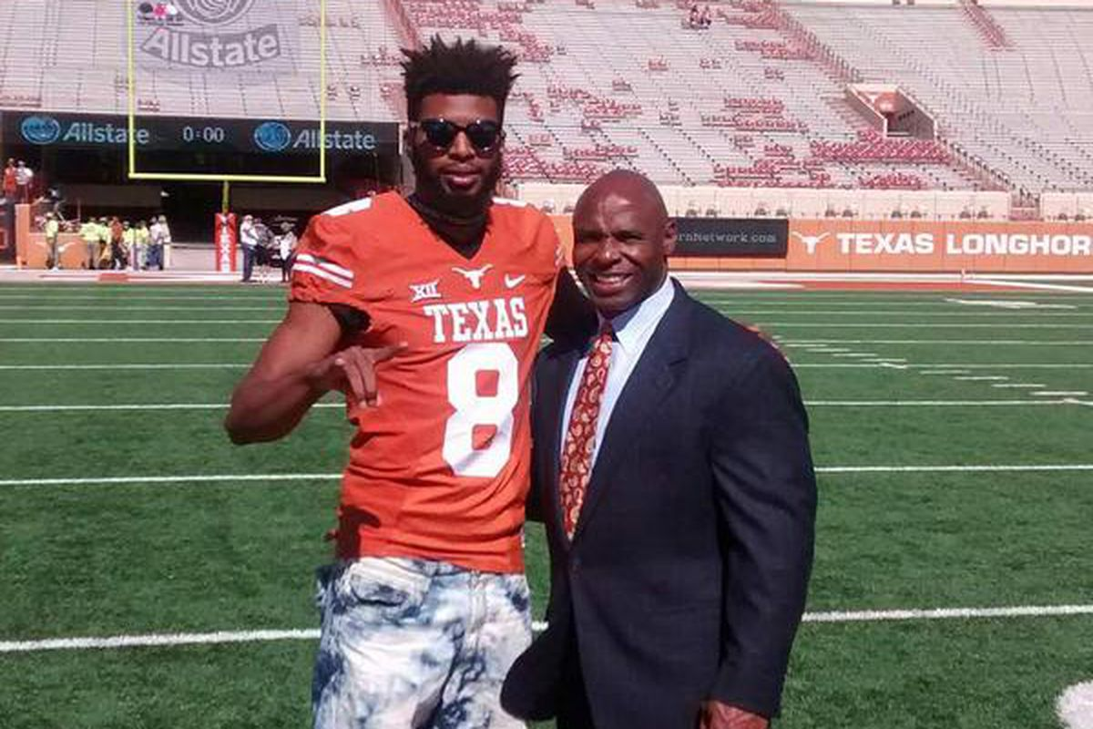 Gilbert Johnson with head coach Charlie Strong in November