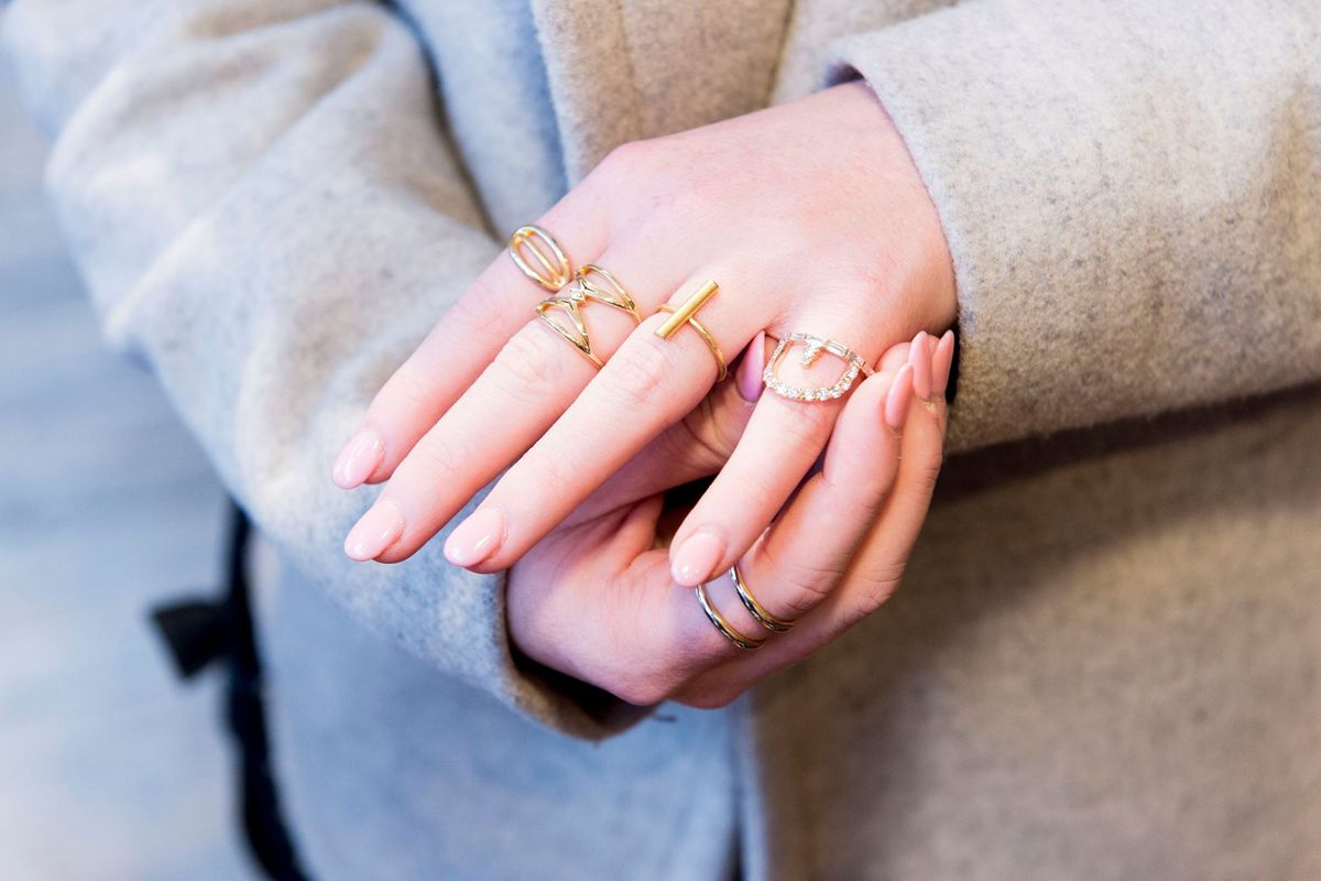 A woman with multiple diamond rings