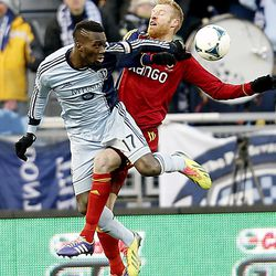 Real's Nat Borchers battles Kansas City's C.J. Sapong as Real Salt Lake and Sporting KC play Saturday, Dec. 7, 2013 in MLS Cup action.