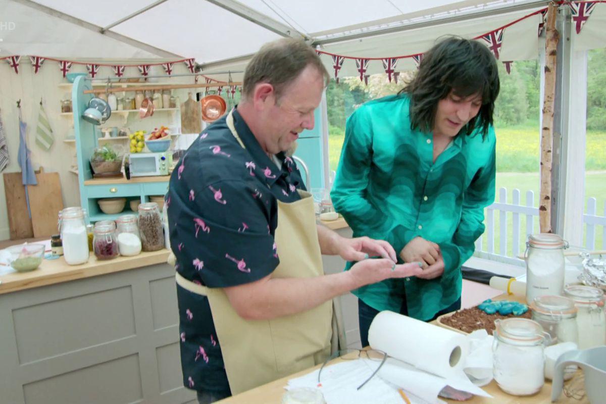 Great British Bake Off's Noel Fielding assists a baker on Channel 4