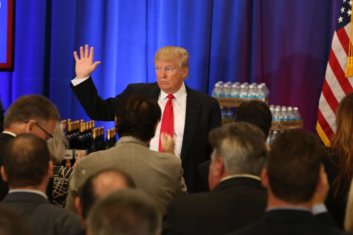 Donald Trump with wine and water behind him