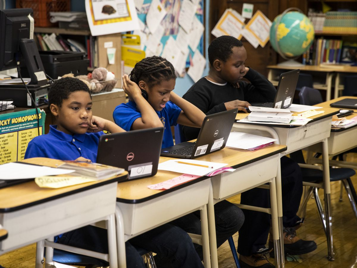 Fourth grade students work on computers at Roswell B. Mason Elementary School on the South Side after a Chicago Teachers Union strike closed schools for 11 days, Friday morning, Nov. 1, 2019. File photo.