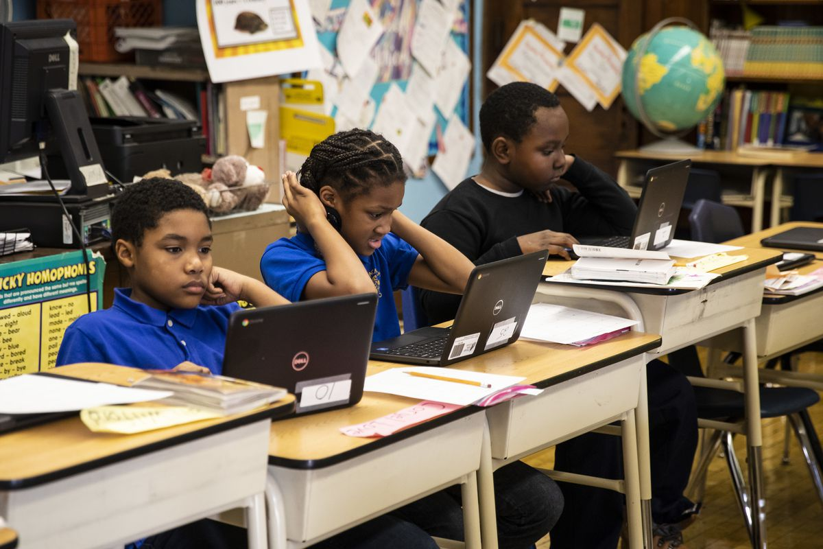 Fourth grade students work on computers at Roswell B. Mason Elementary School on the South Side after a Chicago Teachers Union strike closed schools for 11 days, Friday morning, Nov. 1, 2019.