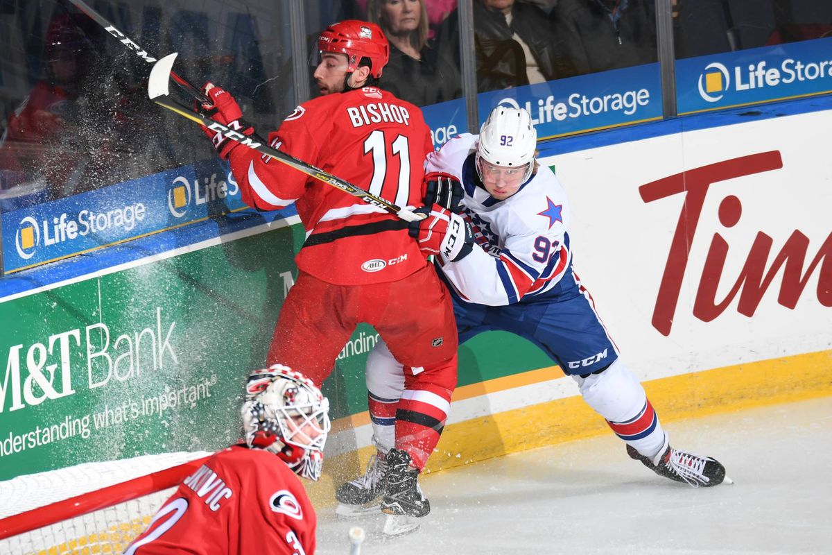 Alexander Nylander (92) completes a check against the Charlotte Checkers on October 6, 2018.