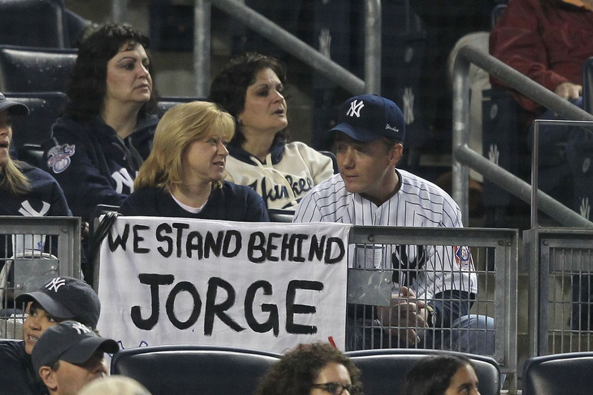 A fan holds a sign in support of <strong>Jorge Posada</strong> of the New York Yankees during their game against the Boston Red Sox on May 15, 2011 at Yankee Stadium in the Bronx borough of New York City.  (Photo by Al Bello/Getty Images)