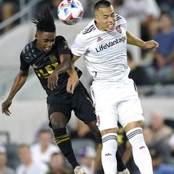 Los Angeles FC forward Latif Blessing, left, and Real Salt Lake forward Bobby Wood try to head the ball during the second half of a Major League Soccer match Saturday, July 17, 2021, in Los Angeles. LAFC won 2-1.