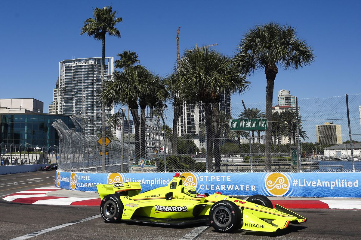 The city of St. Petersburg is pictured in the background in this 2018 photo as IndyCar driver Simon Pagenaud makes his way through turn 10 during practice.