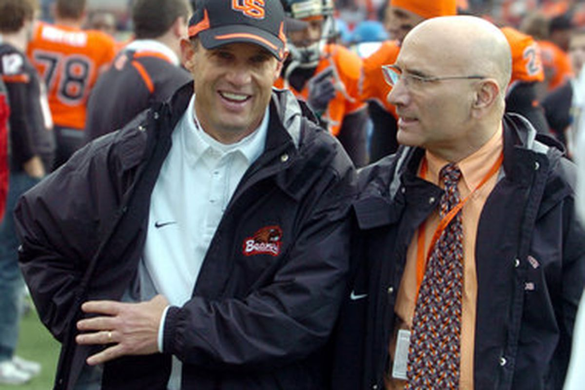 Oregon St. Athletic Director Bob De Carolis (right) has asked head football coach Mike Riley (left) to go through a thorough review of his program, and to find ways to improve. <em>(Oregonian photo)</em>