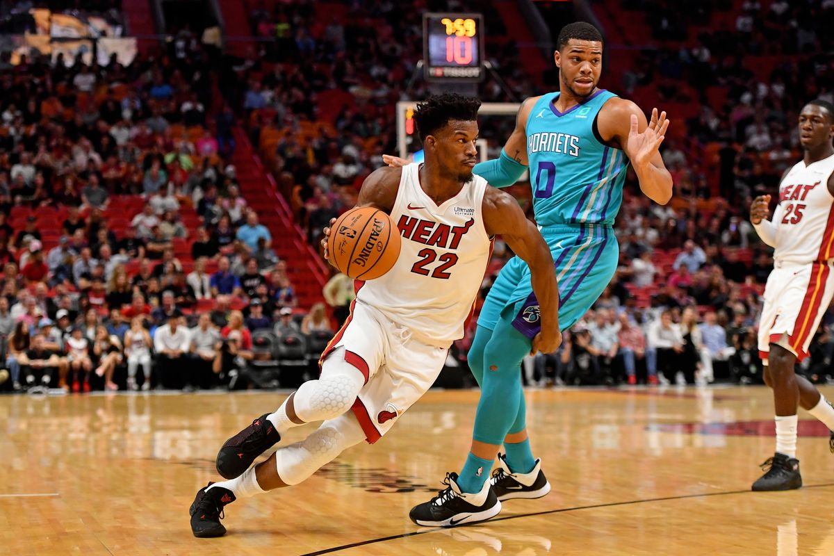 Miami Heat forward Jimmy Butler drives the ball around Charlotte Hornets forward Miles Bridges during the first half at American Airlines Arena.