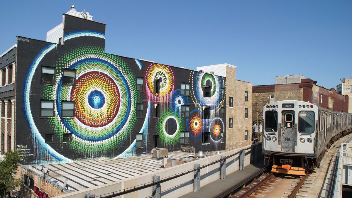 """A southbound Red Line L train passes Joe Miller's """"Uptown Dot King"""" mural at 1124 W. Wilson St. in Uptown. The Lincoln Square artist always wanted to do a large-scale mural that could be seen from a train platform."""