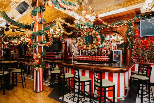 A bar with over-the-top Christmas decorations.