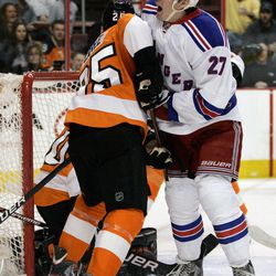 New York Rangers' Ryan McDonagh, right, reacts after scoring during the first period of an NHL hockey game against the Philadelphia Flyers, Tuesday, April 3, 2012, in Philadelphia. Flyers' Matt Carle, is at left.