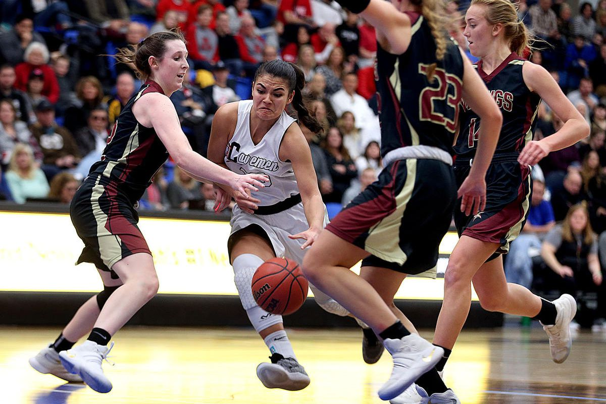 American Fork's Taylor Moeaki drives past Viewmont's Mercedes Staples, left, during 5A girls basketball at Salt Lake Community College in Taylorsville on Saturday, Feb. 25, 2017.