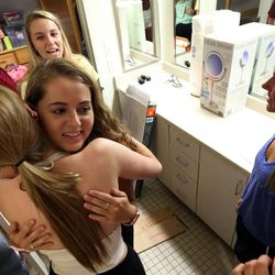 Lauren Hart, in white, hugs Lauren Shapiro, as they meet for the first time in a bathroom that connects their dorm rooms on move-in day at the University of Utah in Salt Lake City on Thursday, Aug. 17, 2017. Behind Shapiro is Shapiro's roommate, Allie Sruberg. On the right is Hart's roommate, Heather Boland.