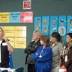 Suzanne McFadden, left, speaks to teachers.