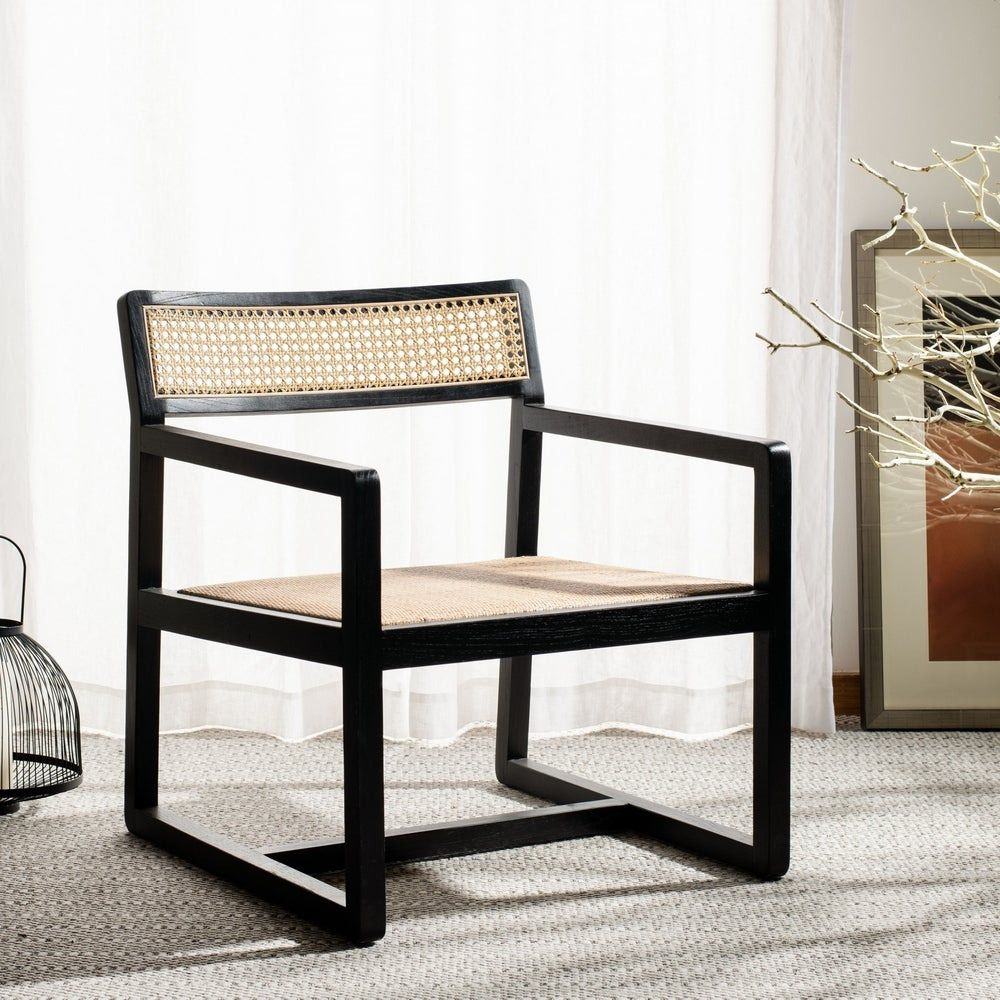 An armchair with off-white woven seating and a black wood frame.