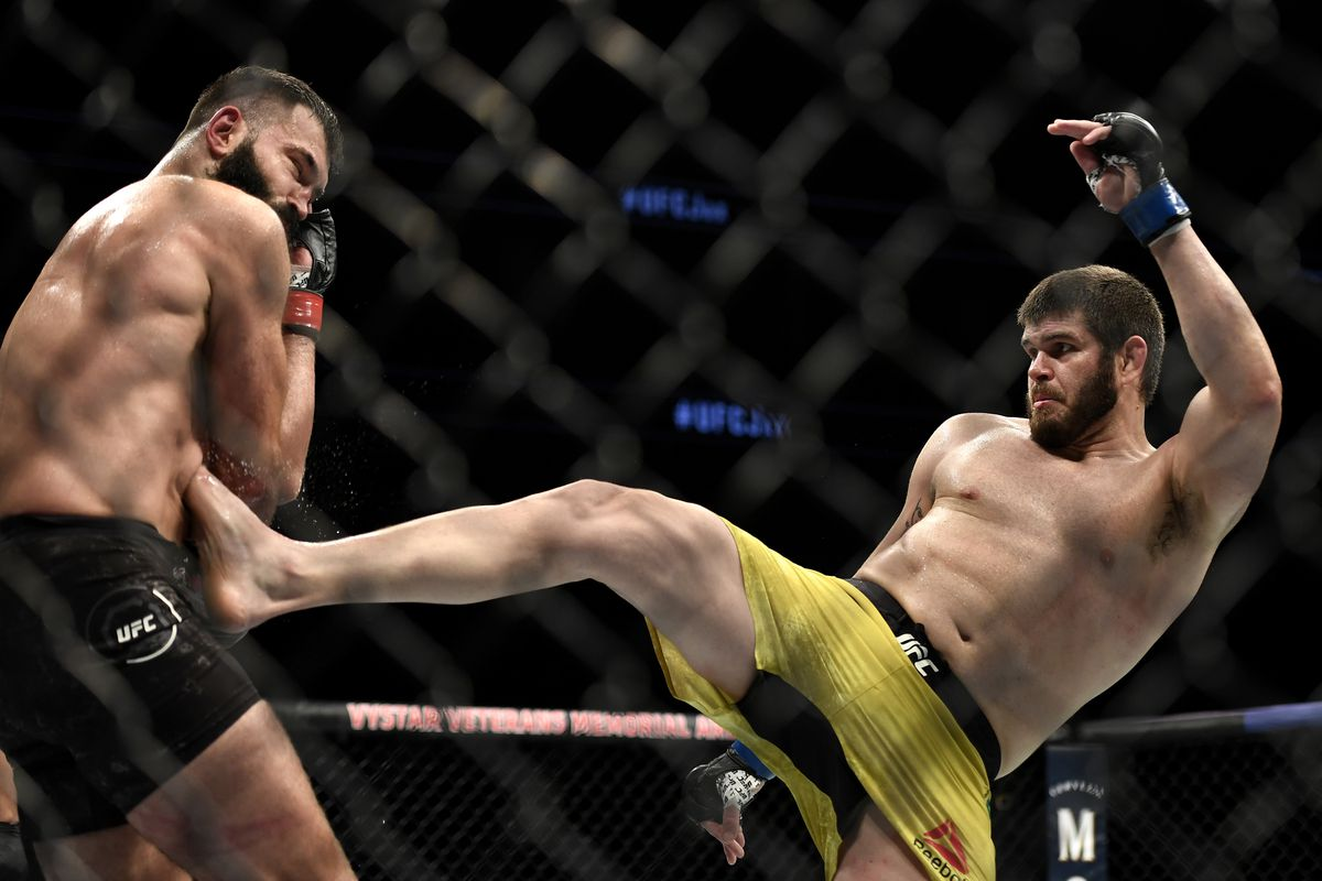 Andrei Arlovski (L) of Belarus fights Philipe Lins (R) of Brazil in their Heavyweight bout during UFC Fight Night at VyStar Veterans Memorial Arena on May 13, 2020 in Jacksonville, Florida.
