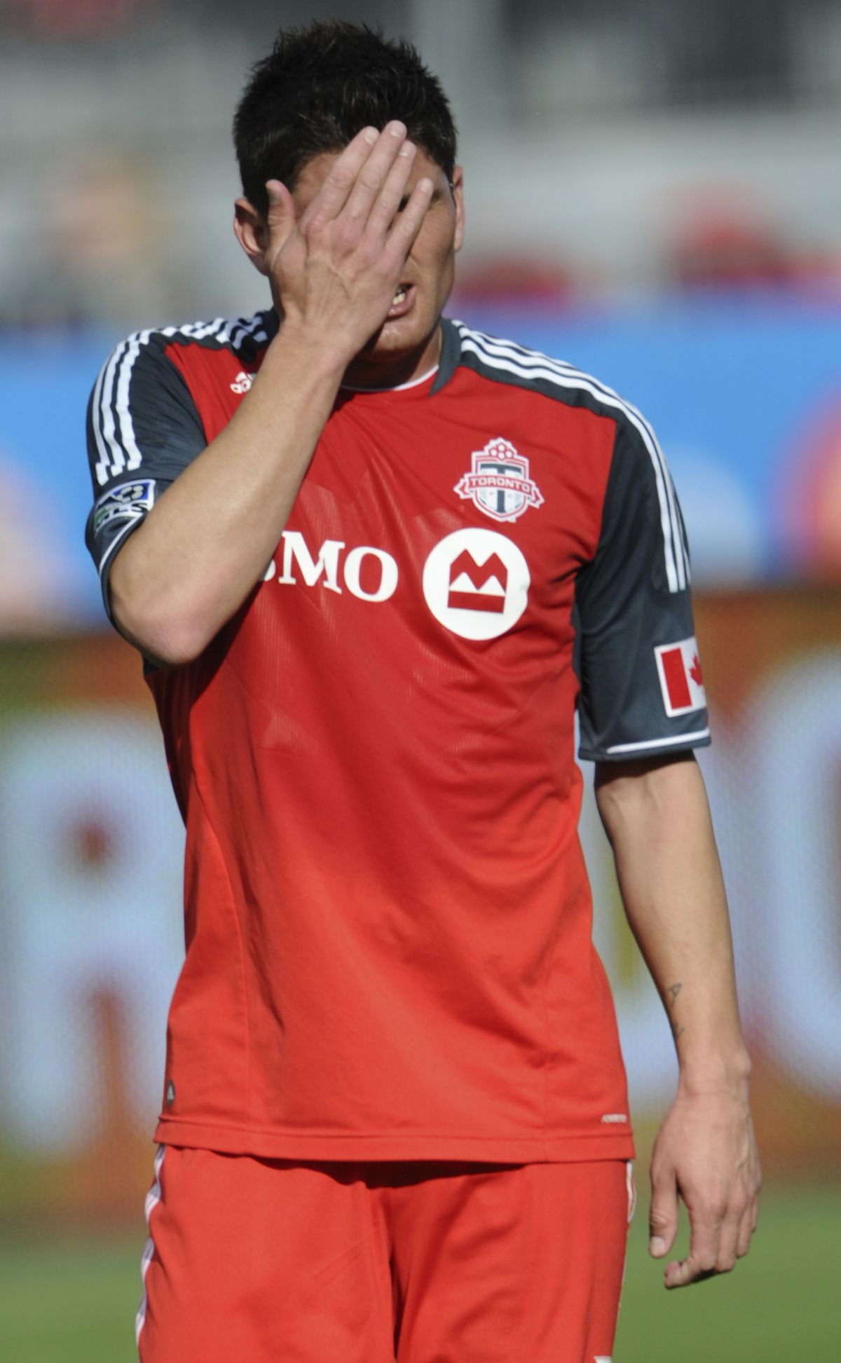 12-05-05 - TORONTO, ONTARIO - TFCs Miguel Aceval, wipes his face with his hand, near the end of the