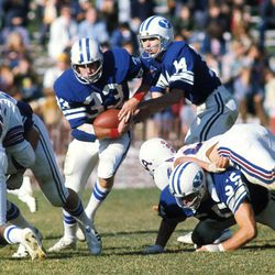 BYU quarterback Gifford Nielsen hands the ball off to Todd Christensen on Oct. 29, 1977. Christensen starred at BYU and in the NFL. He died Wednesday following complications from liver transplant surgery.