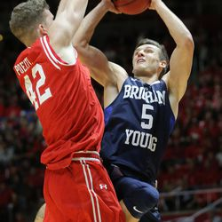 Utah Utes forward Jakob Poeltl (42) defends Brigham Young Cougars guard Kyle Collinsworth (5) as Utah and BYU play in the Huntsman Center in Salt Lake City Wednesday, Dec. 2, 2015.