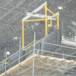 Contractors working on the left-field line upper-deck electronic display board -