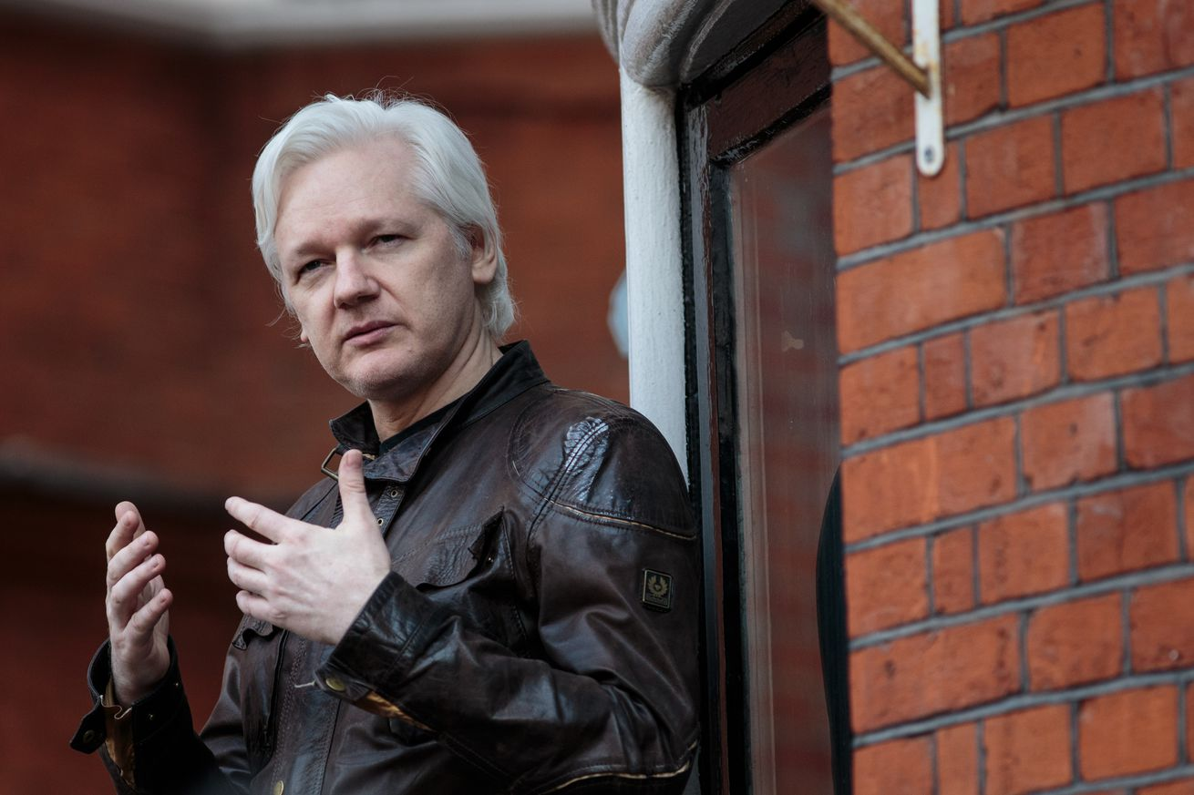 charges against julian assange revealed in apparent copy and paste error