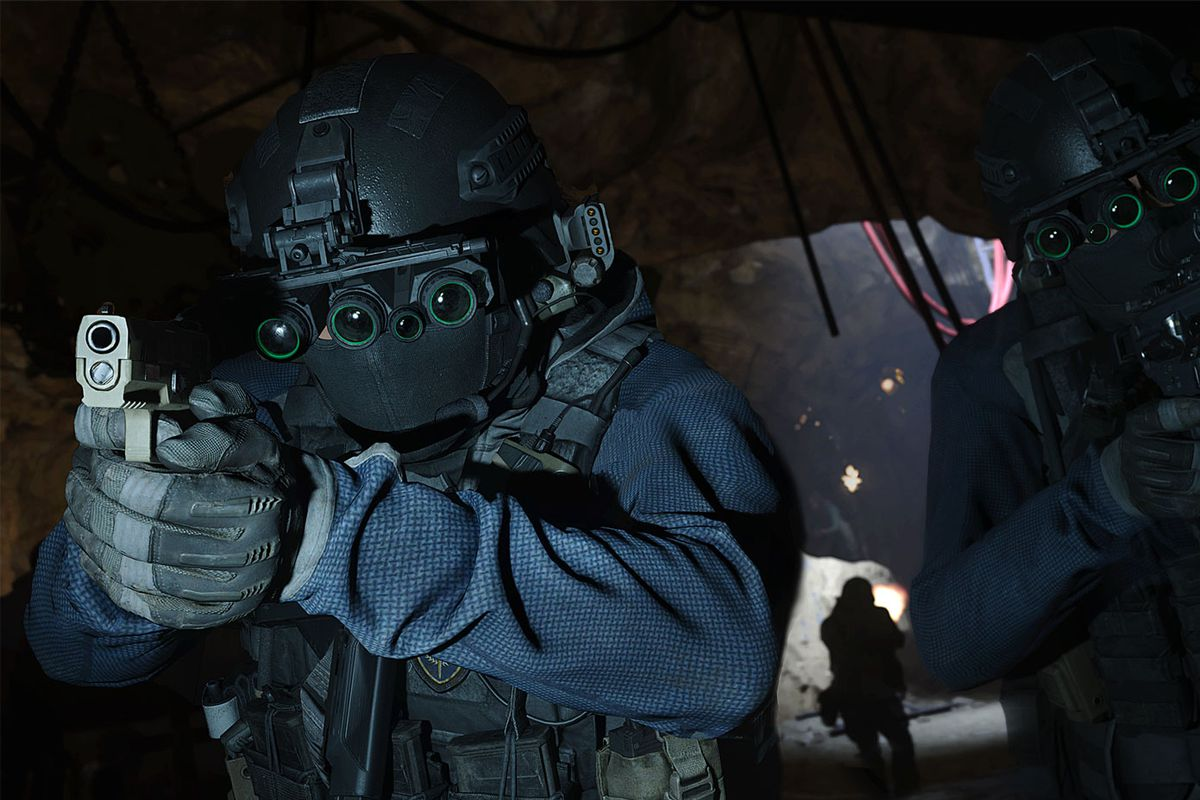 Two soldiers with guns and night vision goggles walk forward in Call of Duty: Modern Warfare